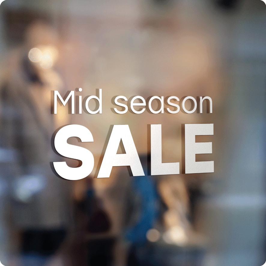 Voorbeeld 'Mid Season Sale' raamtekst wit