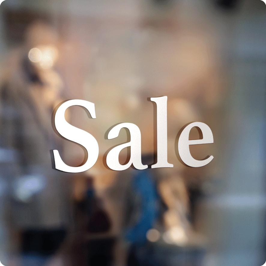 Voorbeeld 'Sale' raamtekst wit